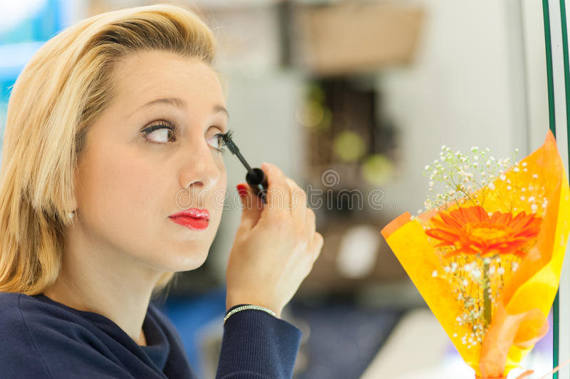 Download Woman applying mascara stock image. Image of horizontal - 39502451