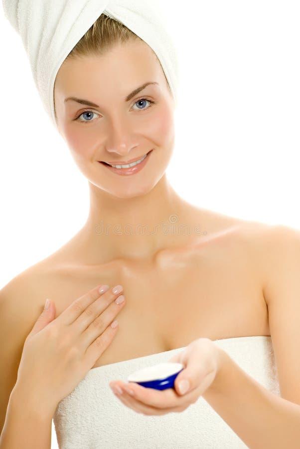 Woman applying moisturizer royalty free stock photo
