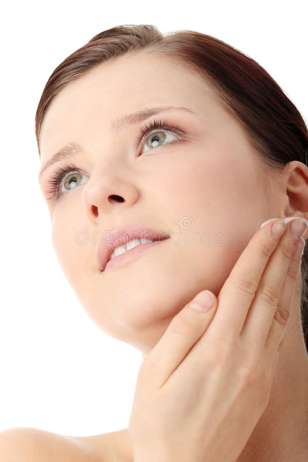 Woman applying moisturizer cream on face royalty free stock image