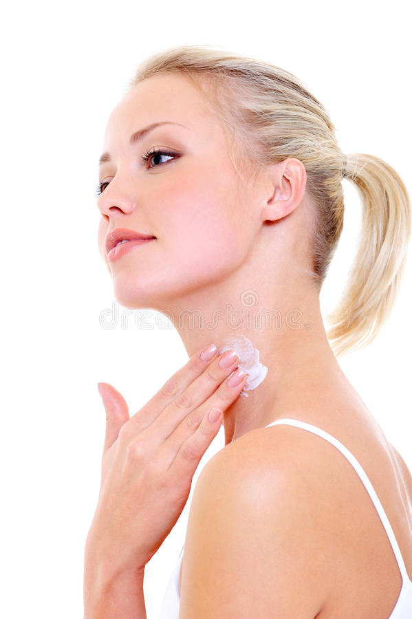Free Woman Applying Moisturizer Cream On Her Neck Royalty Free Stock Image - 11273366