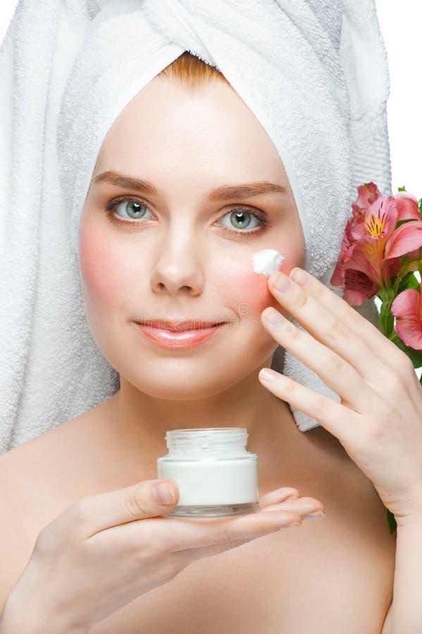 Free Woman Applying Moisturizing Cream Royalty Free Stock Images - 24425639