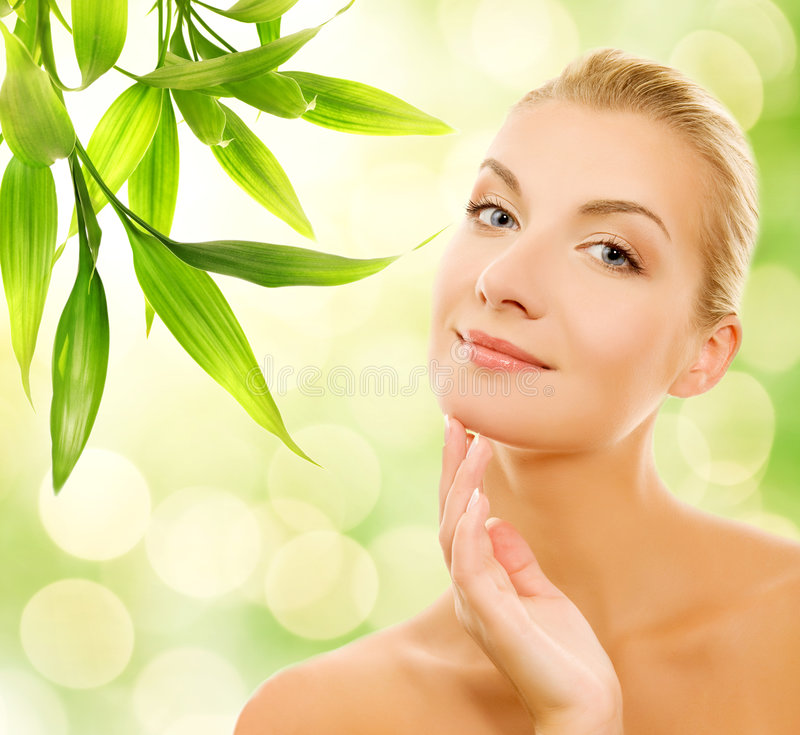 Woman applying organic cosmetics royalty free stock photography