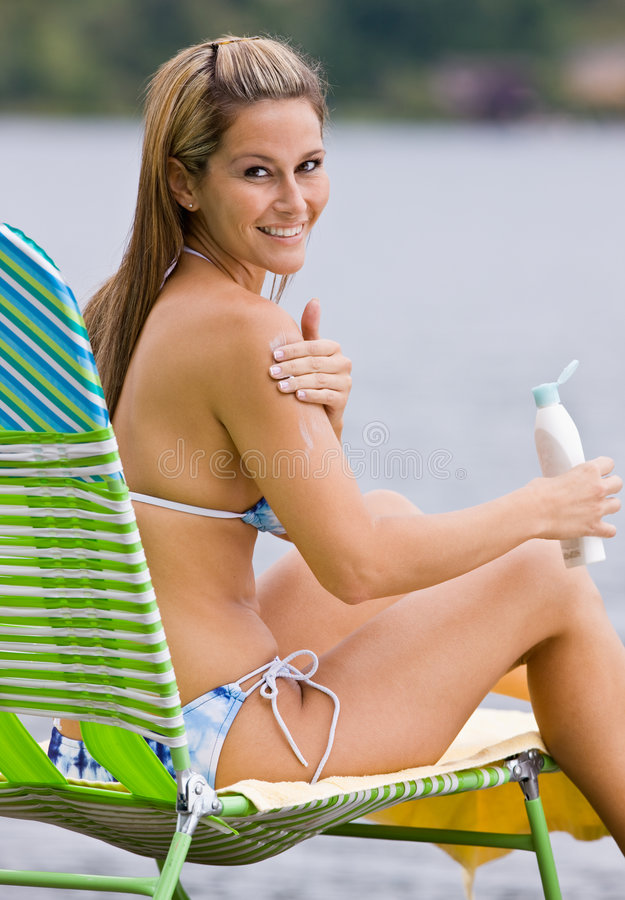 Download Woman Applying Sunscreen Lotion Stock Image - Image: 7379565