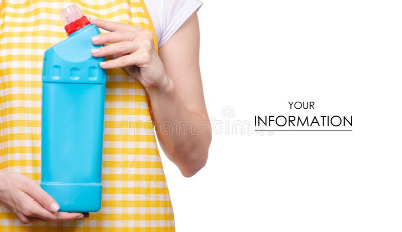 Woman in apron in hands domestic toilet detergent household chemicals pattern. On white background isolation royalty free stock photography