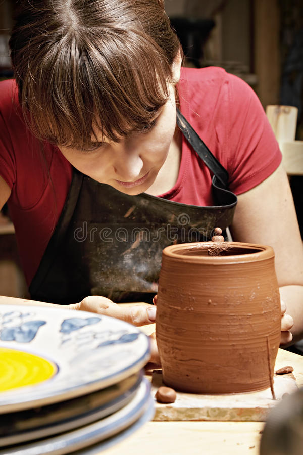 Download Woman In Apron Looking At Jug Stock Image - Image: 22801513