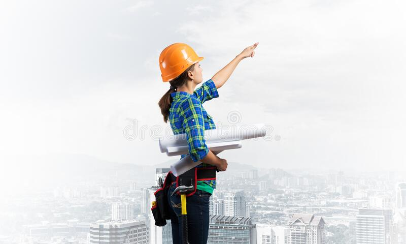 Woman architect in checkered blue shirt stock photos