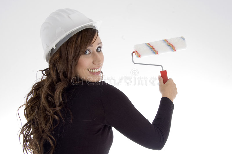 Woman With Architect Helmet And Paint Brush Stock Photography