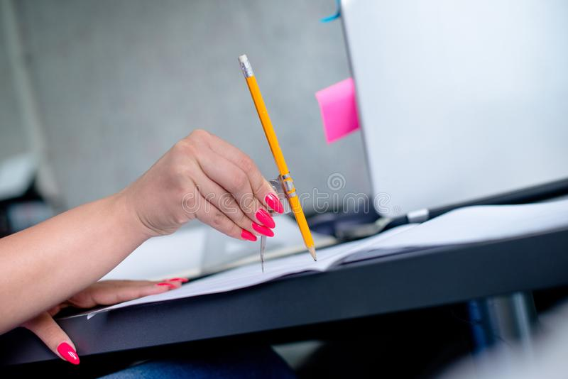 Woman architect making sketches royalty free stock photos