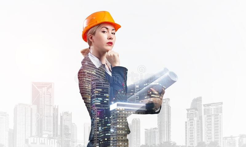 Woman architect with technical blueprints stock photo