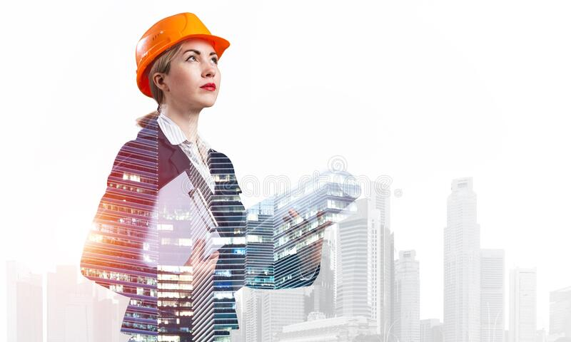Woman architect with technical drawings royalty free stock images