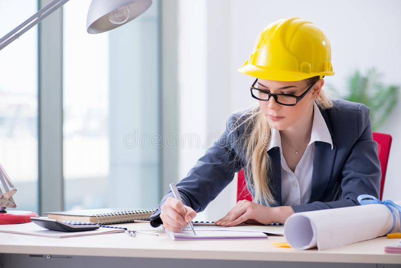 Woman architect working on the project stock images