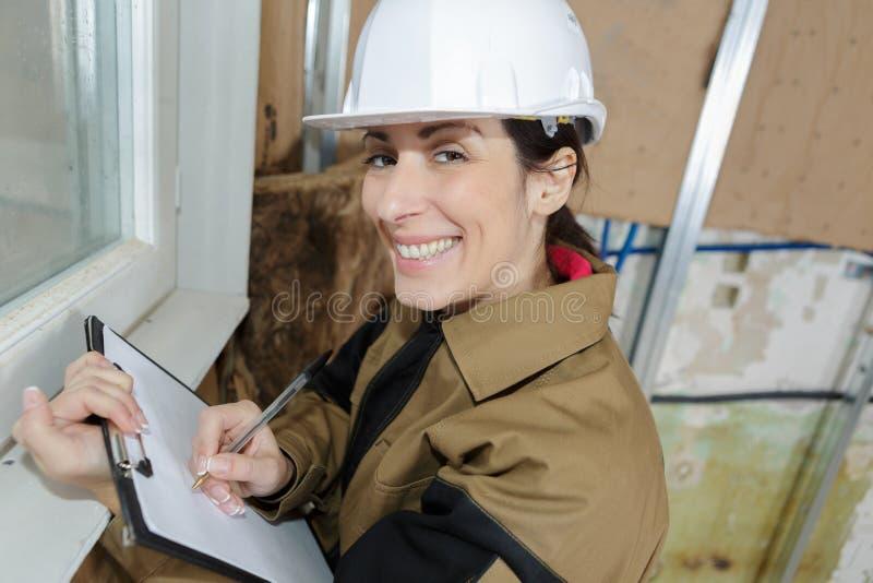 Woman architect writes on clipboard royalty free stock photo