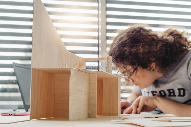 A Woman architecture student working on models stock photo