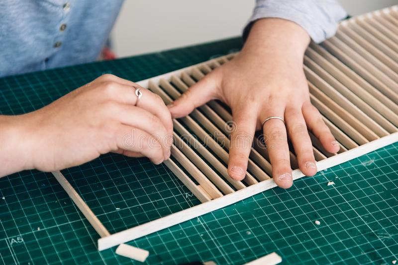 A woman architecture student working on models royalty free stock photography