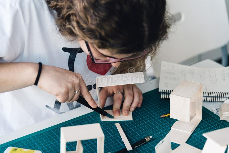 Woman architecture student working on models stock images
