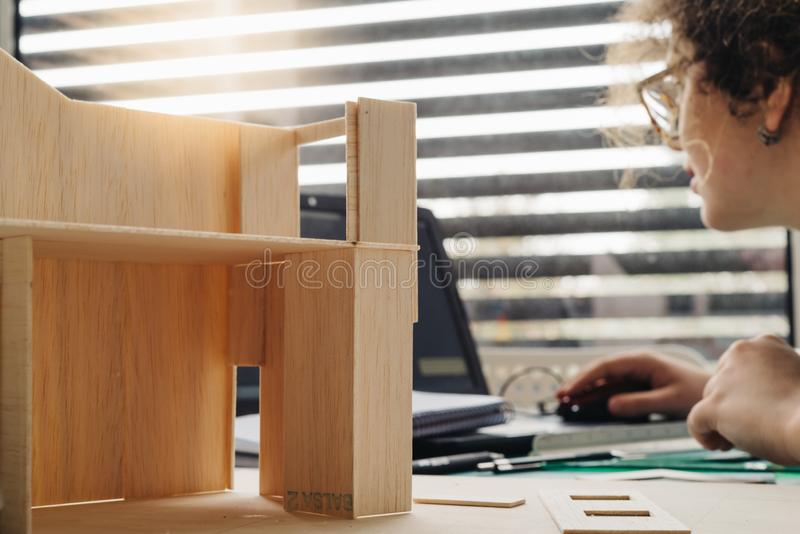 A woman architecture student working on models royalty free stock photos