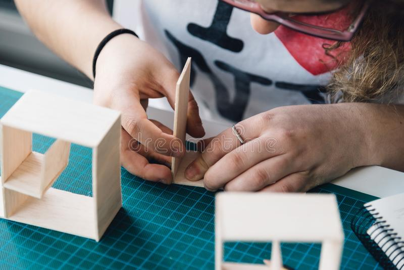 Woman architecture student working on models royalty free stock photo