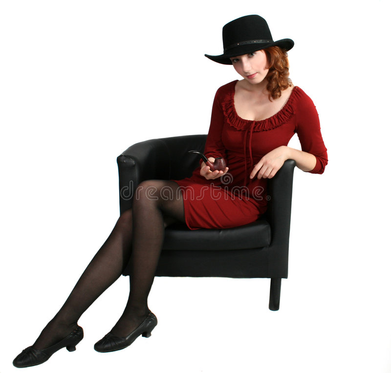A woman in an armchair stock image