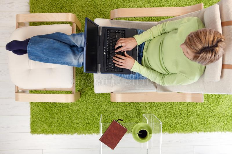 Download Woman In Armchair With Laptop Stock Photo - Image: 41198372