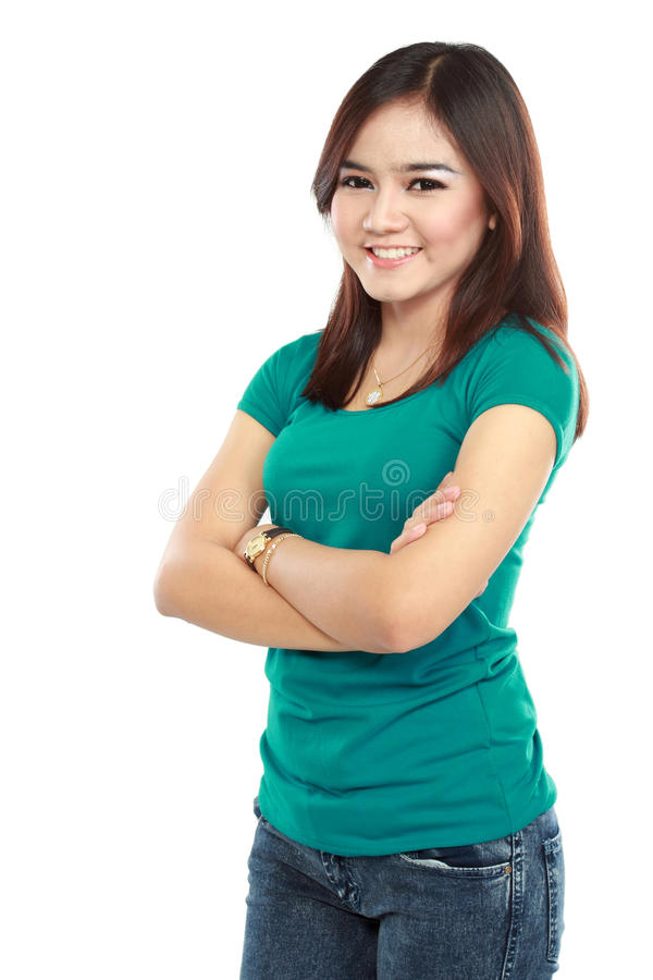 Woman with arms crossed and looking at camera stock images