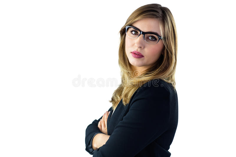 Woman with arms crossed looking at camera. On white background royalty free stock image