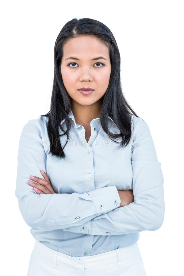 Woman with arms crossed looking at camera. On white screen royalty free stock images