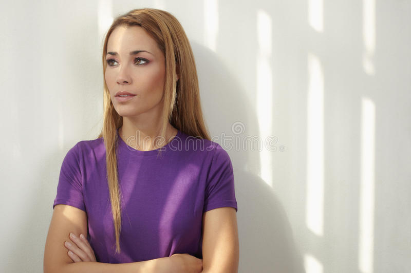 Download Woman With Arms Crossed On White Wall Stock Image - Image: 17169641