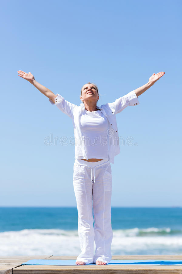 Woman arms reach out beach. Healthy middle aged woman arms reach out on beach stock photography