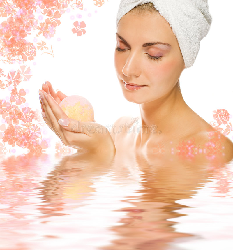 Woman with aroma bath ball. Beautiful young woman with aroma bath ball reflected in rendered water royalty free stock photography
