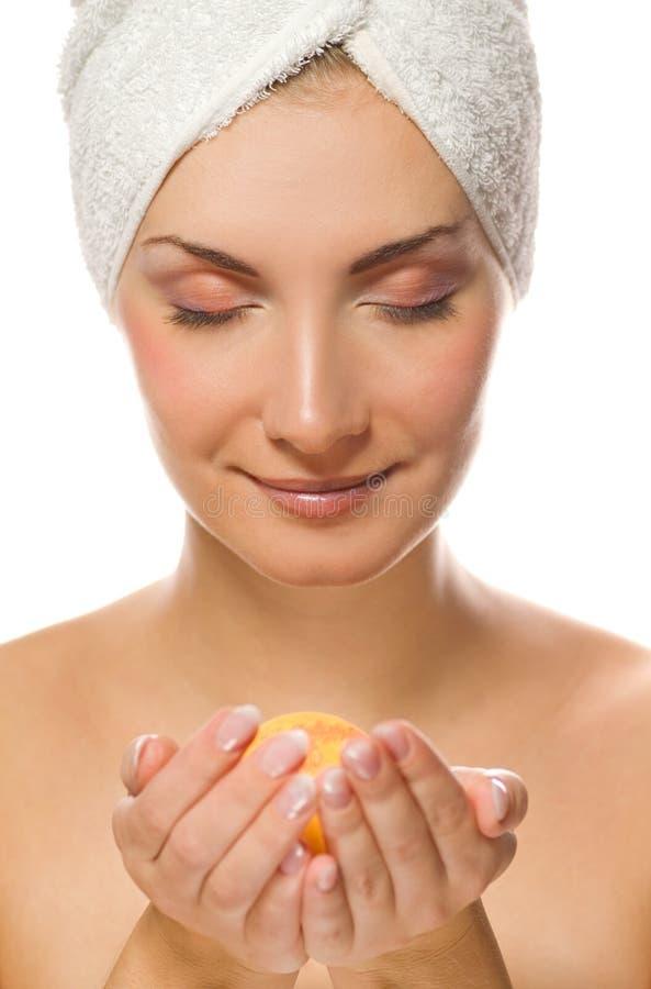 Woman with aroma bath ball stock image