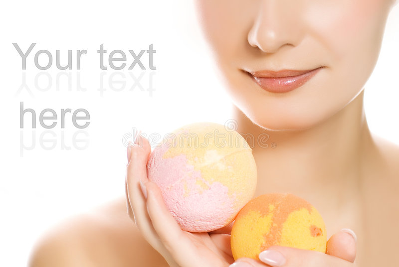 Woman with aroma bath ball stock photography
