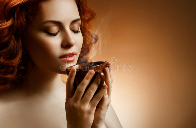 Woman With An Aromatic Coffee In Hands Royalty Free Stock Image