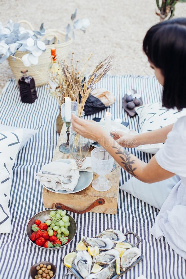 Woman arranges wedding picnic decorations royalty free stock photography