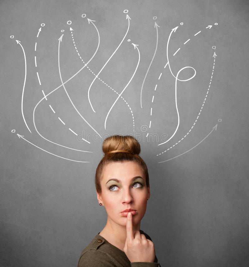 Woman with arrows coming out of her head. Pretty young woman thinking with arrows in different directions above her head stock photography