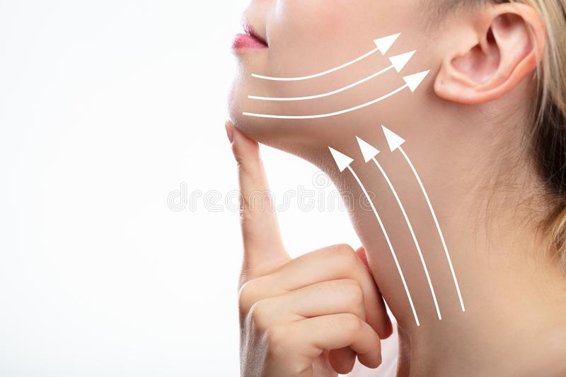 Woman With Arrows On Her Face stock image