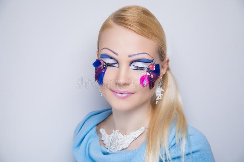 Woman art make up Violet feathers stock photo