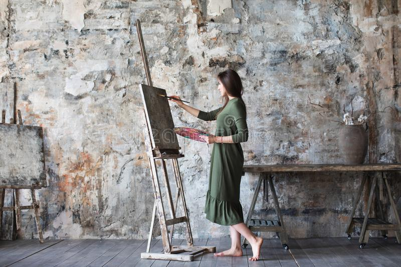 Woman in an art studio while drawing. Hobby stock photography
