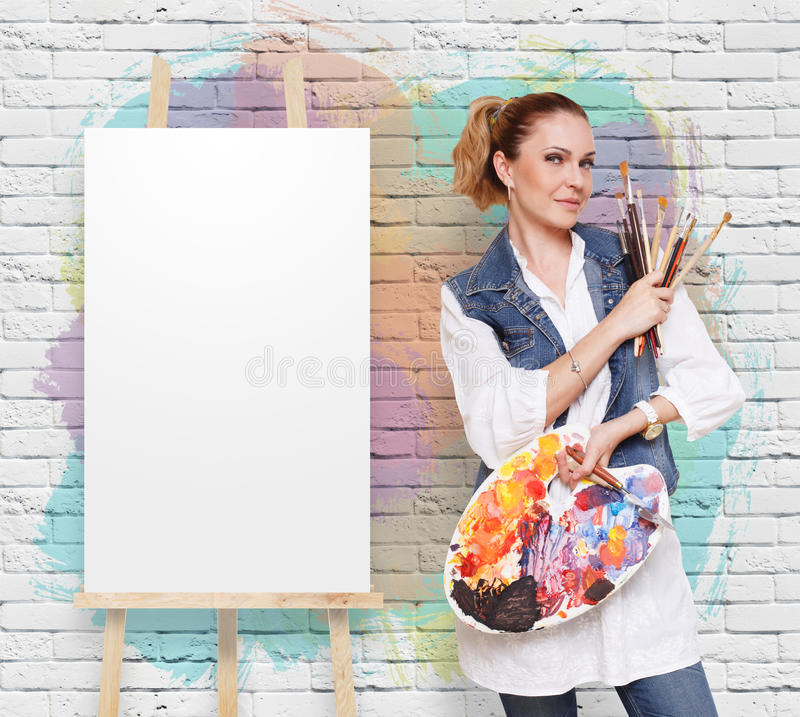 Woman artist with brushes, palette and copy space royalty free stock photos