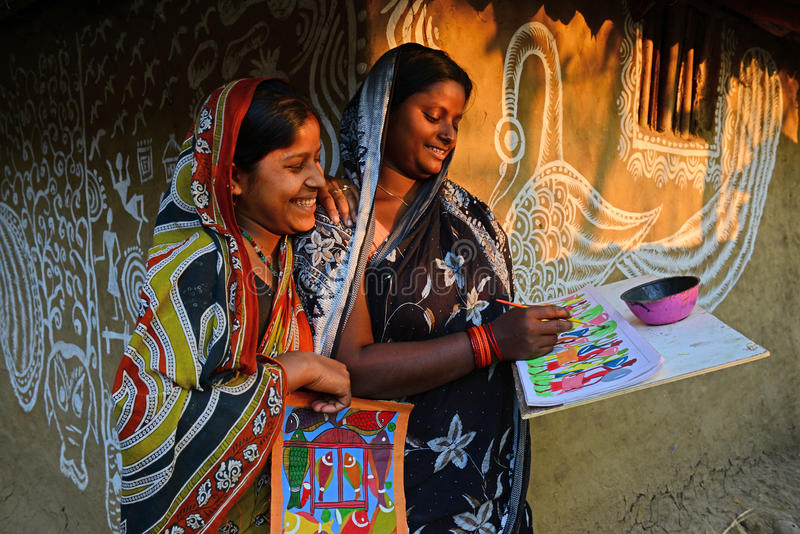 Woman Artist. A woman doing painting in a small tribal art village in West Bengal-India, where a few families having a traditional form of inherited folk art