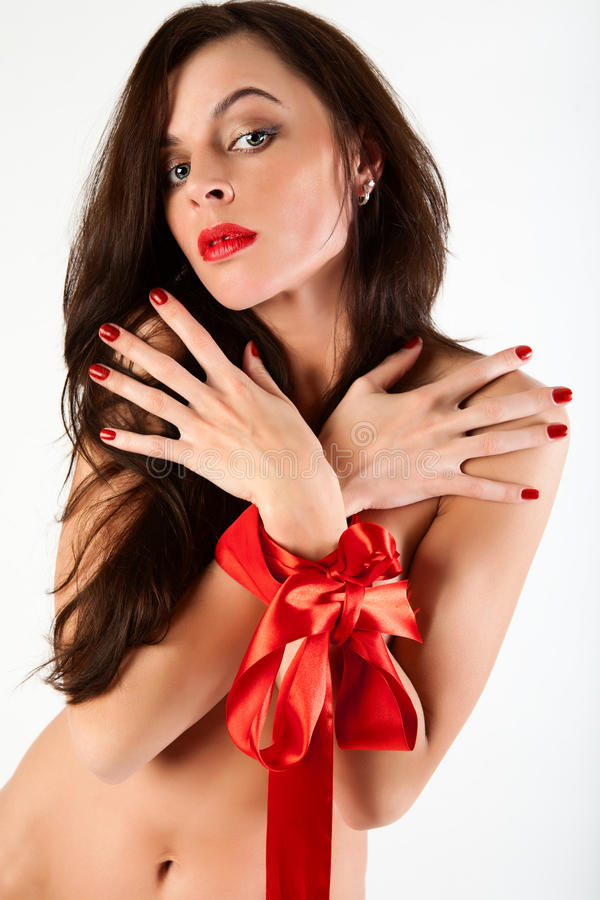 Woman as a gift for the holiday. stock photography