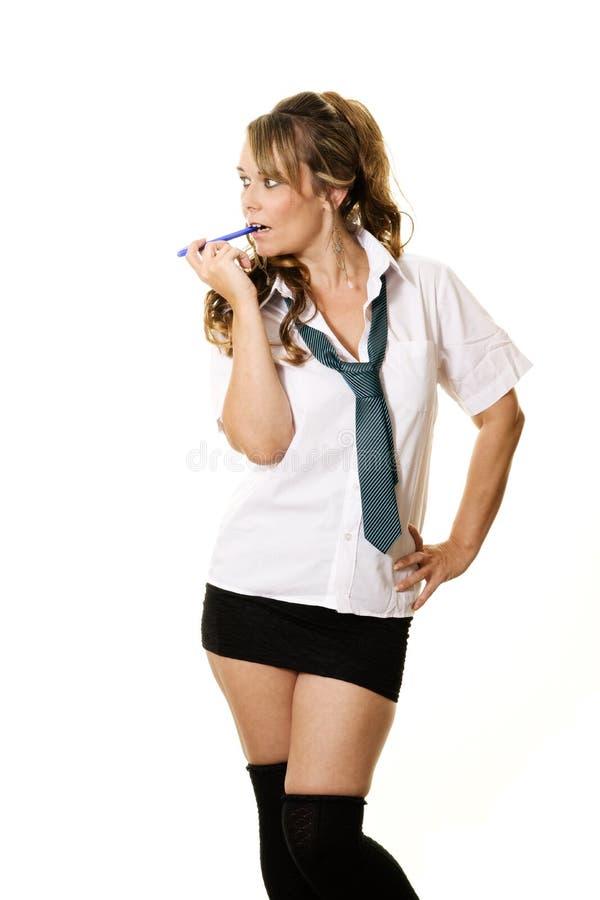 Woman as a schoolgirl stock photo