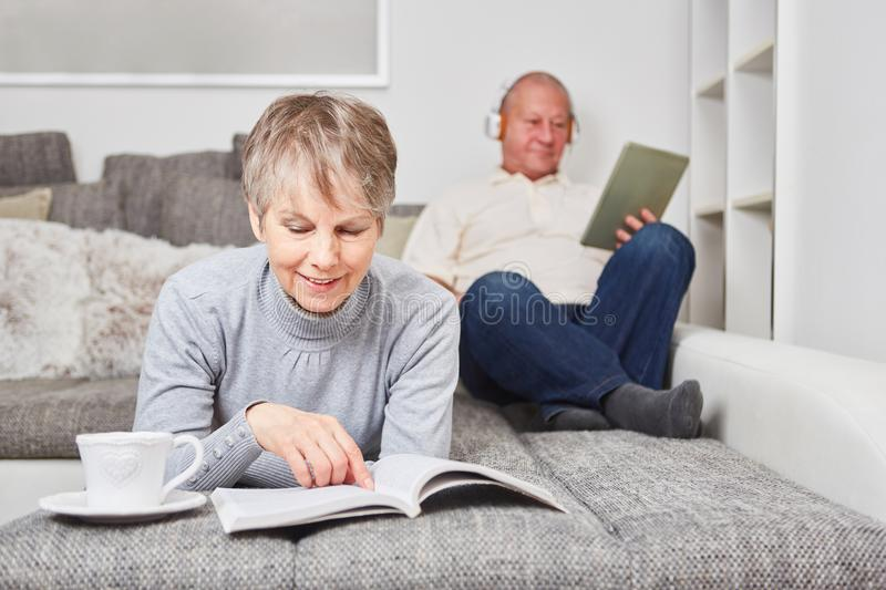 Woman as senior with a book royalty free stock photo