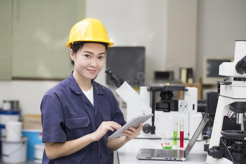 Woman asian engineer doing chemical test in laboratory stock photography