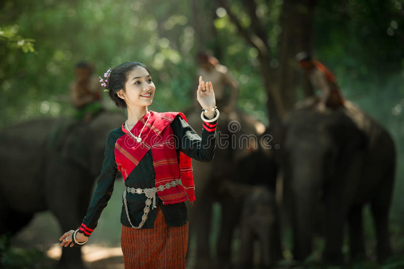 Woman in Asian Tradition dress with Elephant. Woman in Asian Tradition dress at Elephant Village Thailand royalty free stock images