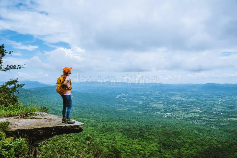 Woman asians travel relax in the holiday. is on the cliff. Travel nature in the holiday. camping summer royalty free stock images
