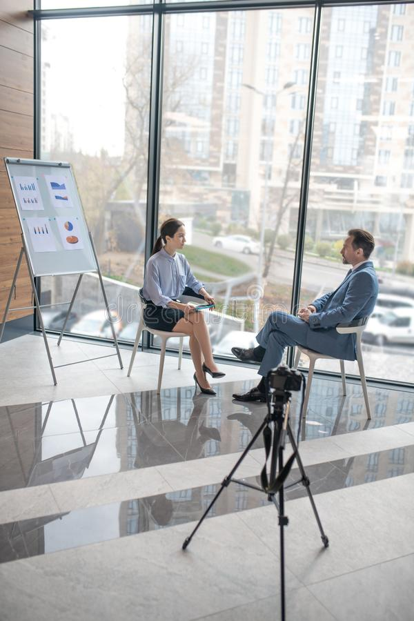 Woman asking her questions while interviewing successful businessman royalty free stock photography