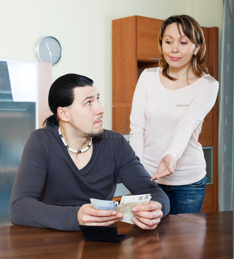 Woman asking for money from husband. Money in family. Woman asking for money from husband royalty free stock image