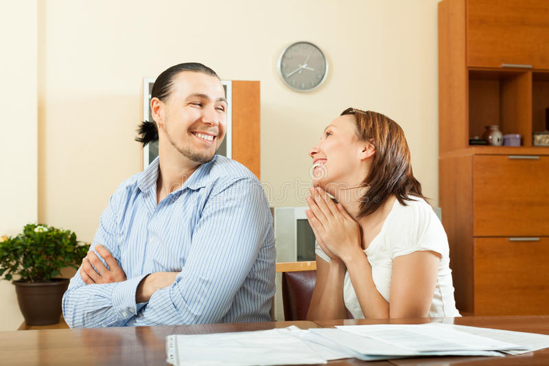 Woman asking for money from husband. Happy women asking for money from her husband for the purchase stock images