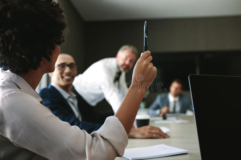 Woman asking a query during a meeting royalty free stock photos