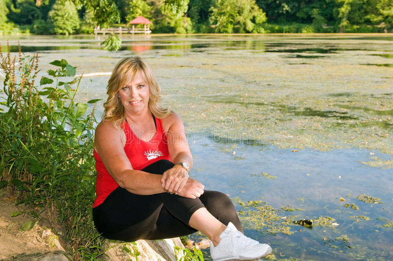 Woman Athlete Beside Pond Royalty Free Stock Image